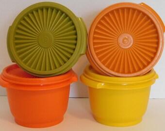 Four Tupperware bowls
