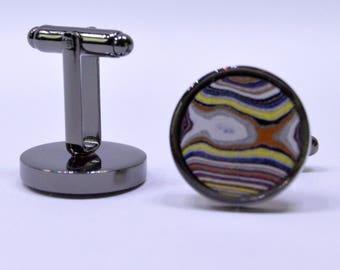 Unusual cufflinks with fordite circular cabochon