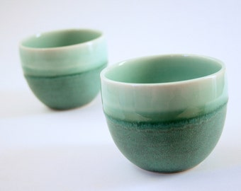 Pair of teal coffee cups