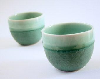 Pair of teal coffee cups