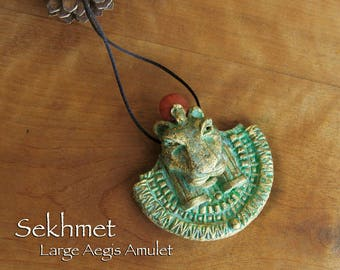 Sekhmet Aegis Amulet Large -  Lioness Goddess She Who Is Powerful -Handcrafted Clay Pendant -Carnelian Solar Disc - Aged Golden Brass Patina