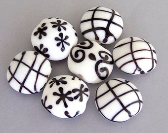 7 black and white beads, lampwork glass, 20mm x 18mm lentil shape, snowflake design