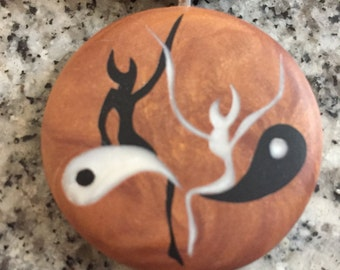 Yin Yang people hand carved on a polymer clay bronze color background. Pendant comes with a FREE necklace