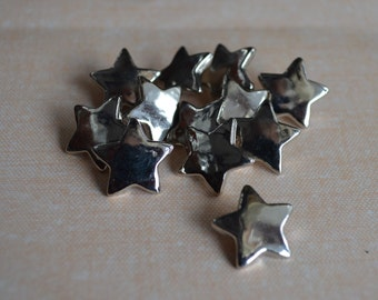 12 Small Three-Quarter Inch 19 mm Plastic Acrylic Silver Star Shaped Buttons (1 with broken shank)