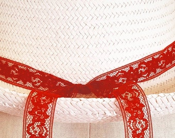 sun hat with hand-tacked hand-singed red lace trim