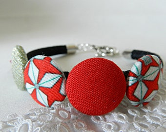 Bracelet with red graphic fabric beads