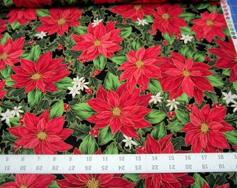 Christmas Holly and Poinsettias with tiny white flowers on Black cotton quilting fabric from Quilting Treasures  BTY