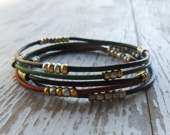 Set of 5 leather bangles with silver and gold plated  beads , beaded leather stackable bracelets , boho chic , tribal jewelry