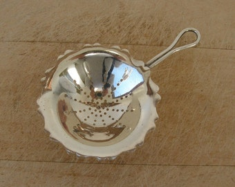 SILVERPLATE TEA STRAINER English Bowl Shape with Fluted Sides Three Hoof Feet Loop Handle Made in England Mid 1900's