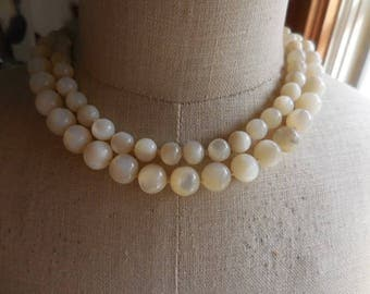 Vintage 1950s to 1960s Mother of Pearl Round Beaded Double Strand Necklace Adjustable Knotted Shell MOP Gold Tone Retro Beige