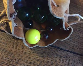Vintage leather bag of marbles