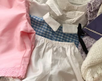 Lot of 15 plus vintage homemade babydoll clothes 5 blouses! Its an adorable lot of fun! Hand knitted sweater blanket bonnet so sweet!