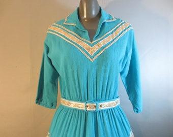 "1950's Southwest Squaw Dress, Patio Dress, Turquoise with Gold Trim // Matching Belt, Elastic Waist  // 3/4 Raglan Sleeves...30-32"" waist"
