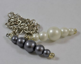 Pendulum:  Graduated White & Gray Glass Pearls