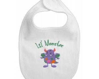 Lil Monster embroidered feeding bib.