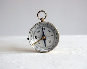 vintage brass pocket compass