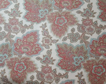 Lario by 3 sisters for Moda pink background with red and blue designs in leaf shapes and vines 1/2 or 1 yard