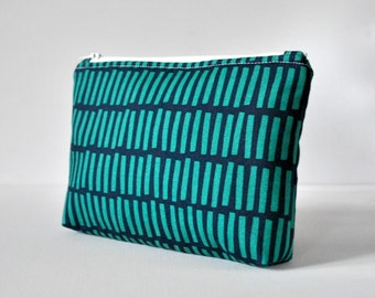 Padded aqua green navy blue line block travel make up pouch cosmetics bag modern print in large.