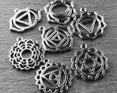 7 Silver Chakra Charms 29mm to 31mm Mixed Set