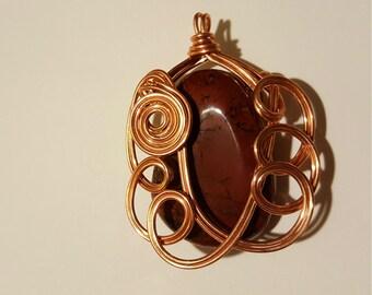 Red Jasper Pendant Wrapped in Swirling Copper Wire Spirals