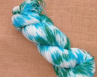 "Hand dyed British Bluefaced Leicester/nylon sock yarn in ""Palm fronds by the sea"""