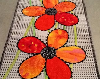 Table runner or wall hanging with bright orange flowers on black checks