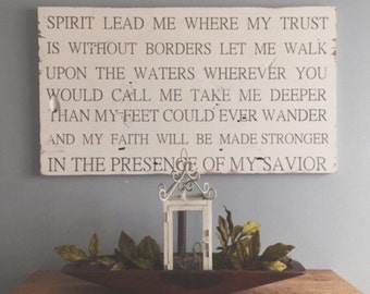 Spirit lead me where my trusts are without borders lyrics painted on barn wood. Oceans by Hillsong.