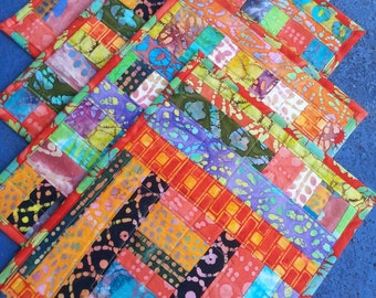 Set of four quilted placemats handmade with cotton batik fabric scraps washable reversible modern quilt art OOAK one of a kind table linens