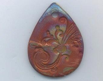Dazzling raku pendant - 5396 - matte rust with silvery blue accents - 50 x 38 mm