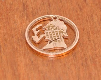 Coin cut charm. Sherlock Holmes with smoking pipe. UK bronze penny