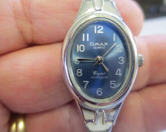 "Vintage lady's watch ""Omax"" Quartz silver and gold tone metal linked large band with snap closure   used watch"
