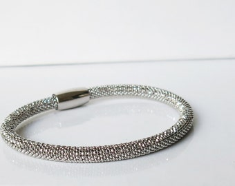Sterling silver diamond cut mesh style bracelet with magnetic closure