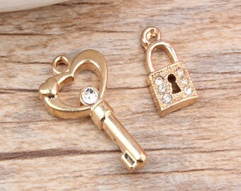 3 sets of  K gold alloy key and locket pendant accessories