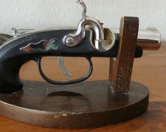 1960's Fake Percussion Pistol Cigarette Lighter On Original Wood Stand w/ Advertisement on Stand