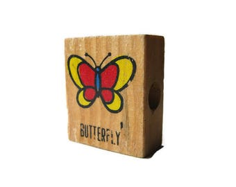 vintage children's wooden number blocks and a butterfly!