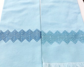 Matching set of blue huck hand towels with Swedish embroidery - two different shades of blue embroidery