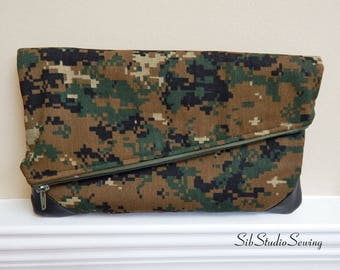 Camouflage Fold Clutch, 12 x 7.5 Inches Folded, Inside Pockets, Zipper Closure, Angled Top, Vegan Leather Corners, Camo Fold Over Clutch