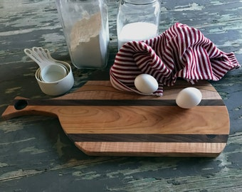 Handmade cutting board 18 inches long with Cherry, Curly Maple, and Walnut