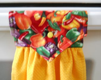 PEPPERS, Beautiful, colorful peppers on the top of a yellow hanging kitchen towel. Has  top that snaps over an appliance.