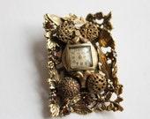 Vintage Watch Brooch with Leaves and Rhinestones, Calvert Switzerland, Musi, Circa 1960's