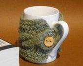 British wool mug cosy / cup cover hand knitted in lichen green wool with wooden button
