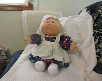 Cabbage Patch Doll with three outfits