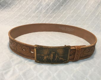 Wonderful old hand-tooled leather belt from 1950's with bronze buckle.