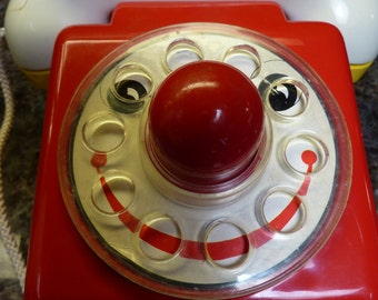 Vintage Red Pull Telephone With A Nose That Squeaks