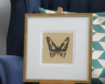 Hand painted butterfly in pen and ink silhouette on gold leaf on paper.