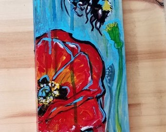 poppy and bumbel bee painted on wood panel