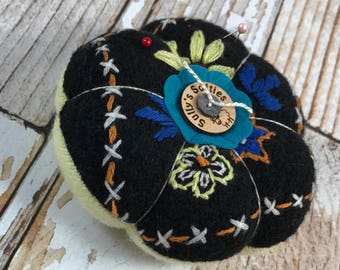 Pincushion from recycled, felted wool sweater.  Pretty embroidery.
