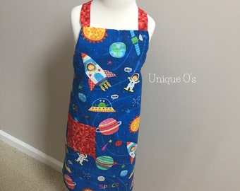 Boys or girls adjustable neck apron, rockets, planets and spaceships and aliens, ready to ship!  One size fits ages 3-10, handmade.