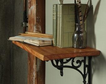 A pair of Vendome shelf brackets