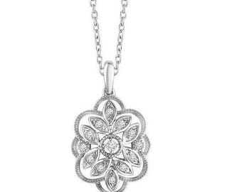 "14k solid white gold floral diamond necklace. chain is adjustable from 16""to 18"". .16ctw diamonds."